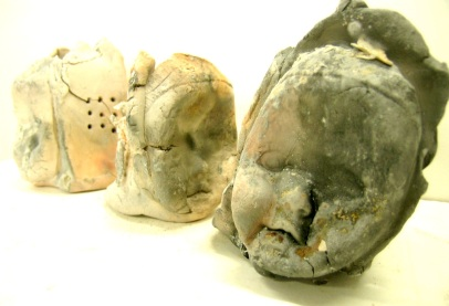 stoneware from molds, saggar-fired at earthenware with organic materials