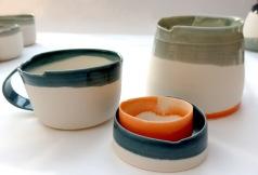 porcelain creamer, cup, sugar dish; asymmetrical edges