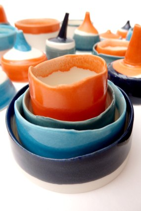 stacked vessels with uneven edges; porcelain