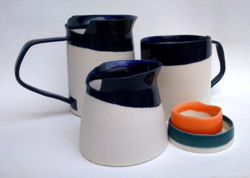 Porcelain vessels with angled handles and asymmetric rims