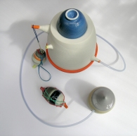 """From the """"Rongo Rongo; Forgotten Function"""" series. Assemblage of porcelain vessels; latex additions"""