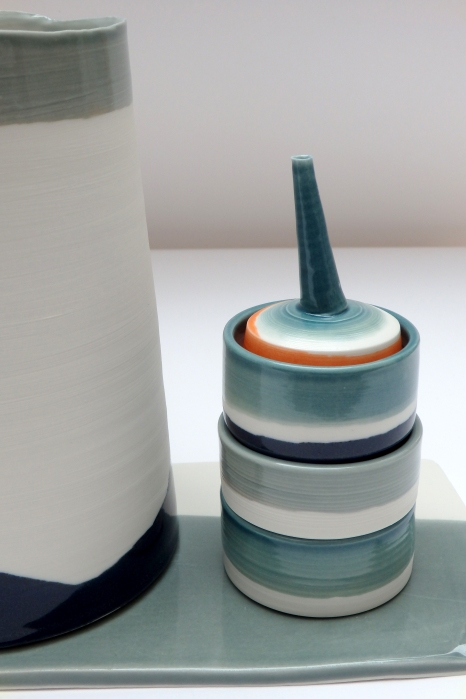 large cylinder with small stacked vessels; porcelain