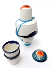 large lachrymatory with dark blue cups; thrown and assembled porcelain with latex additions. Max height = 24 cm