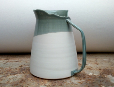 tall grey vessel with shaped handle and asymmetric edge