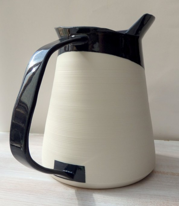 tall jug form w asymmetric rim, porcelain