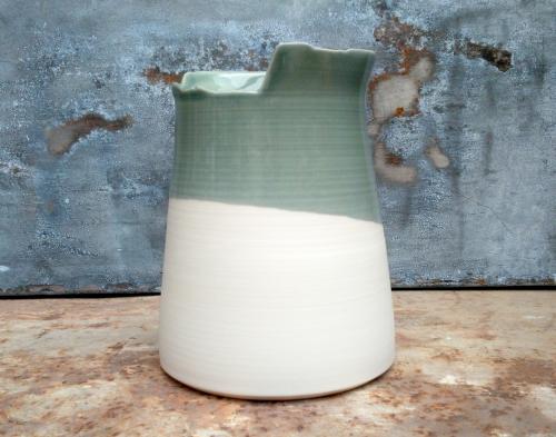 tall grey vase with asymmetric edge