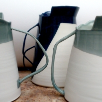 three porcelain vessels w handles and asymmetric edges