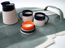 porcelain tray with fractured and uneven edges.