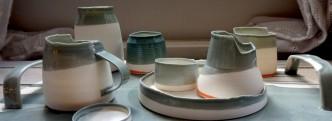 assemblage of grey and orange vessels; porcelain