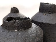 black stoneware vessels with uneven edges