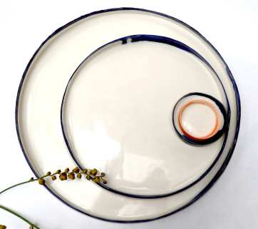 porcelain platters with uneven edges; 32cm max dia