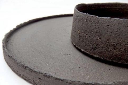 large nested dish set with uneven edges; black stoneware