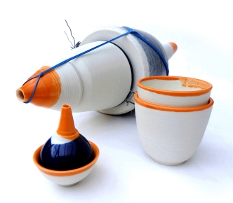 porcelain lachrymatory with orange cups