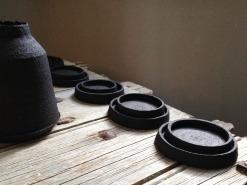 nested dishes and bottle form; black stoneware