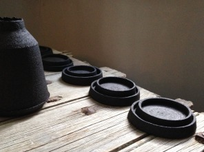 nested dishes and bottle form; black stoneware