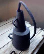 black stoneware, abstract handles
