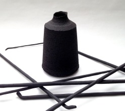 black stoneware bottle form and ceramic quills