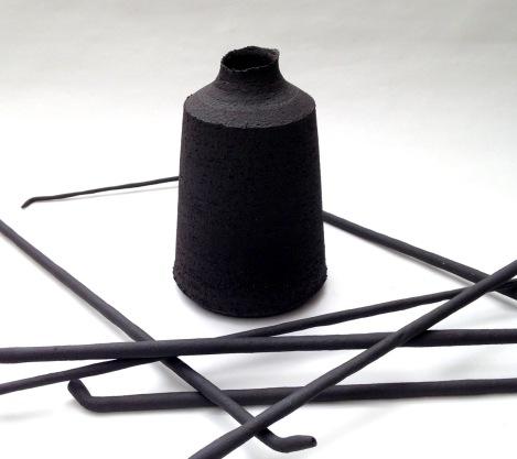 black stoneware bottle form and ceramic quills