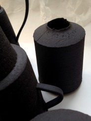 black stoneware jar form with incised surface