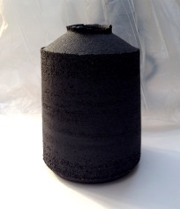 black stoneware jar form