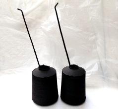 black stoneware jar forms and ceramic quills