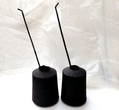black stoneware jar forms and ceramic quills