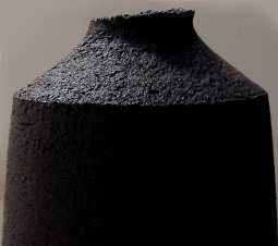 black stoneware bottle form with uneven edge