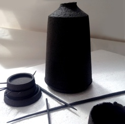 tall bottle form with ceramic quills ; unglazed stoneware