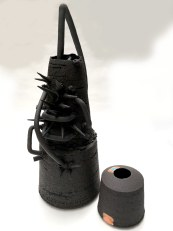 black stoneware abstract vessels with uneven edges
