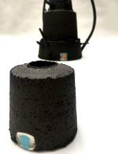 black stoneware vessel with uneven edges
