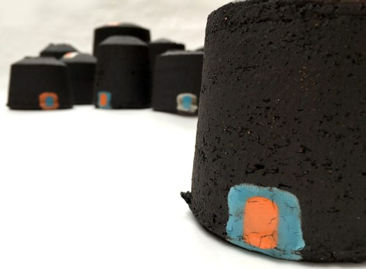 black stoneware vessels with uneven edges; glaze detail