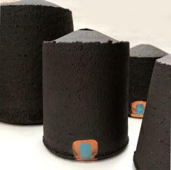 black stoneware vessels with uneven edges