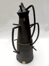 black stoneware abstract vessel with uneven edges