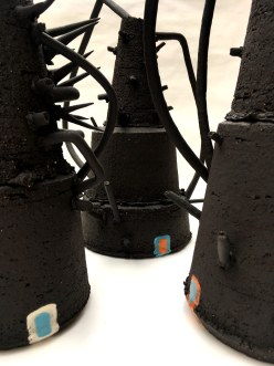 abstract vessels with uneven edges; black stoneware